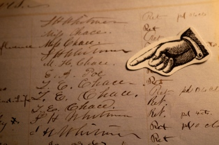 Here you can see Poe's signature in the Athenaeum's charge book.